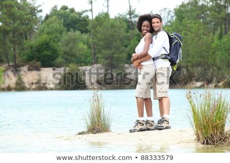 Hiking couple stood by lake Stock photo © photography33