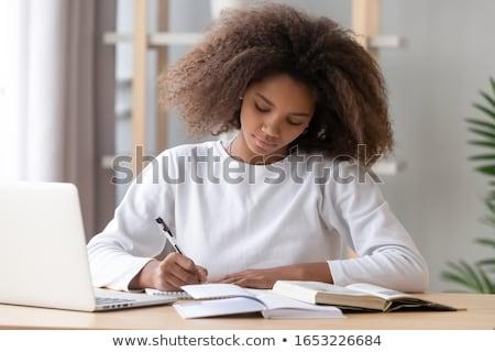 mutlu · öğrenci · kadın · yazmak · notlar · beyaz - stok fotoğraf © shawnhempel