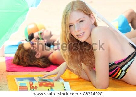 üç gençler güneşlenme kadın plaj kafa Stok fotoğraf © photography33