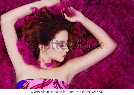pretty brunette with feathered makeup and closed eyes Stock photo © carlodapino