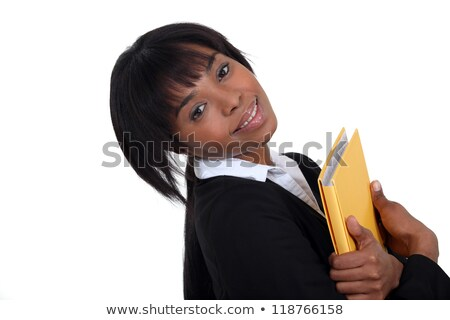 Businesswoman hugging a folder to her chest Stock photo © photography33