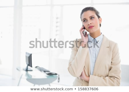 Stern businesswoman making call Stock photo © photography33