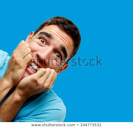 Closeup of frightened young man with funny facial expression aga Stock photo © dacasdo