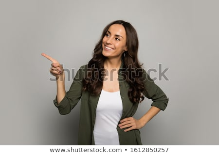 corporate woman pointing away at something stock photo © stockyimages