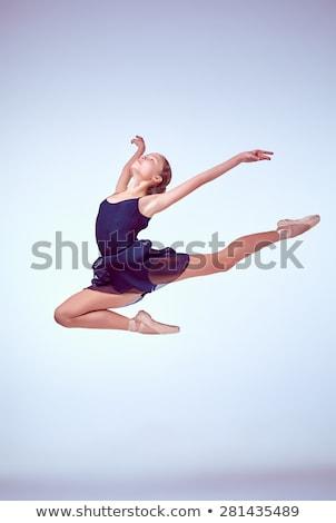 Cute elegant woman in blue dress jumping Stock photo © stepstock