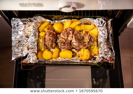 pork neck grilled in the kitchen oven stock photo © artlens