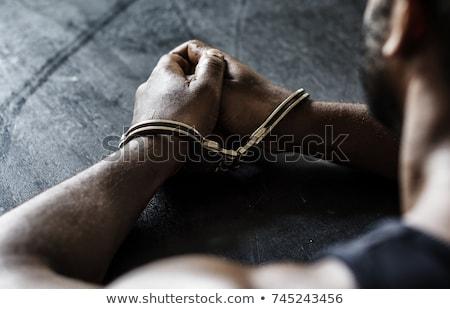 захват наручники рук белый тюрьму пальцы Сток-фото © gemenacom