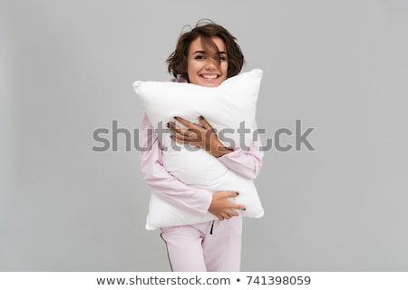 Lány mosoly tart párnák csinos nő Stock fotó © feelphotoart