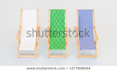Row of chaise longues on tropical resort. Stock photo © kyolshin
