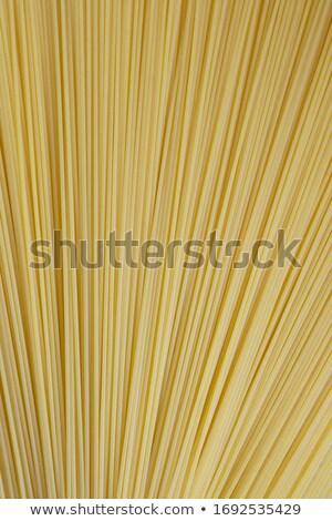 pasta lying horizontally and vertically Stock photo © OleksandrO