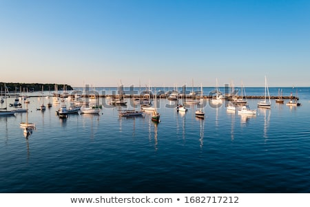 Image of a small yacht sitting on the dock. Stock photo © epstock