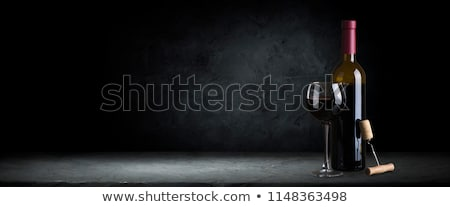Bottle wine and glasses Stock photo © shutswis