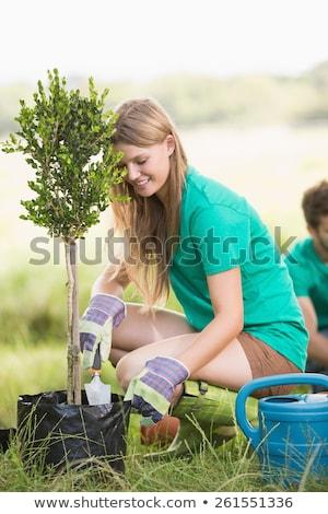 Pretty blonde gardening for her community Stock photo © wavebreak_media