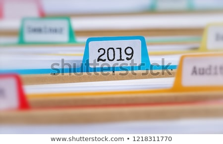 File Folder Labeled as Work Plans. Stock photo © tashatuvango