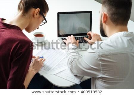 Hátulnézet kettő fókuszált komoly üzletemberek laptopot használ Stock fotó © deandrobot