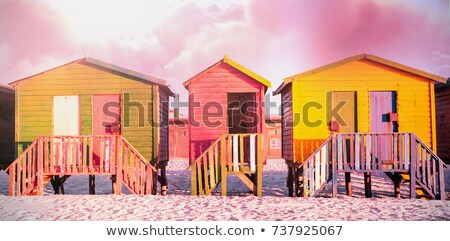 Colorful wooden houses on sand against clear sky Stock photo © wavebreak_media