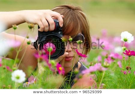 African nature photographer with digital camera. Stock photo © RAStudio