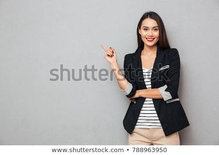 mutlu · gülümseyen · kadın · işaret · parmak · uzak · gri - stok fotoğraf © deandrobot