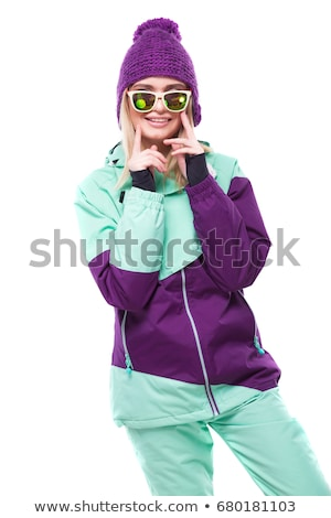 beauty young woman in ski suit and sunglasses ride snowboard Stock photo © Traimak