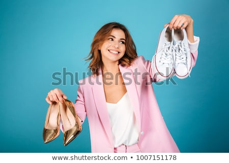 young woman choosing shoes stock photo © is2
