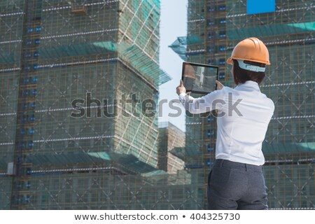 back of woman at building site stock photo © is2