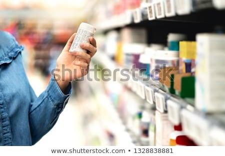 Gyógyszerész néz tabletta üveg orvos orvosi Stock fotó © IS2