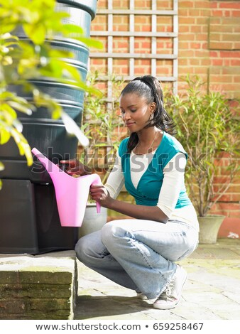 Woman filling jug with recycled water Stock photo © IS2