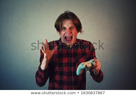 Mani giovani uomo giocare videogiochi computer Foto d'archivio © deandrobot