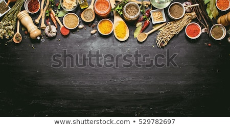 set of spoons and bowls with spices stock photo © dash