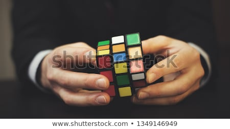 Businessman solves rubik cube stock photo © Minervastock