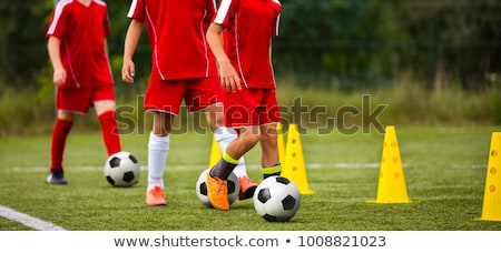 Stock photo: Youth soccer practice drills with cones. Soccer drills: slalom