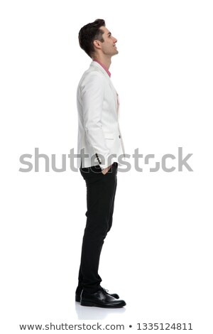 side view of a happy elegant man dreaming away  Stock photo © feedough