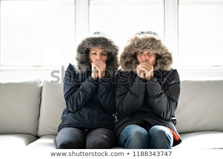 Woman have flu on the sofa at home with winter coat Stock photo © Lopolo