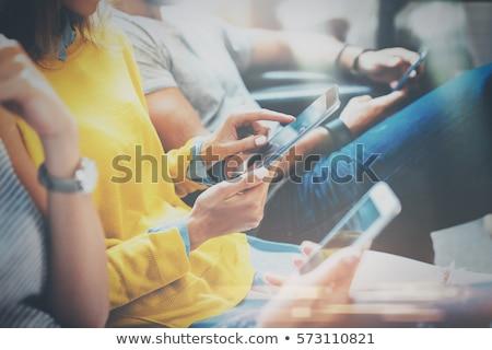 sorridente · jovem · mulher · atraente · telefone · móvel · café · em · pé - foto stock © neonshot
