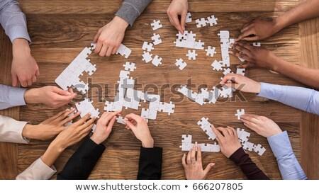 üzletemberek · puzzle · csoport · fa · asztal · üzlet · papír - stock fotó © andreypopov