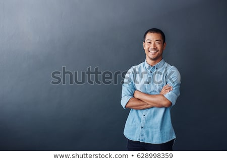portrait of a laughing young asian man stock photo © deandrobot