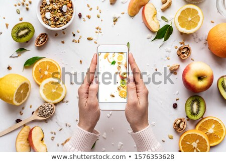 food blogger using smartphone taking photo blogger girl stock photo © illia