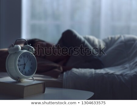 Somnolent jeune femme oreiller réveil Photo stock © pressmaster