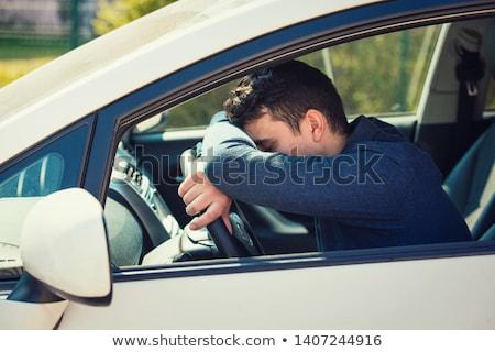 Férfi dől fej kormánykerék bent autó Stock fotó © AndreyPopov