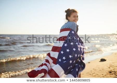 kadın · amerikan · bayrağı · mutlu · gündelik · gri - stok fotoğraf © wavebreak_media