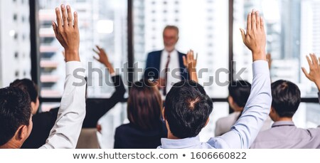 Front view of diverse group of business professionals listening to speaker at a business seminar in  Stock photo © wavebreak_media