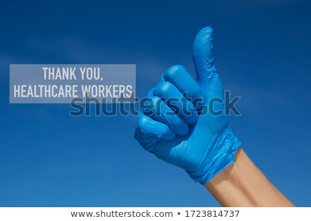 man wearing surgical gloves giving a thumb sign Stock photo © nito