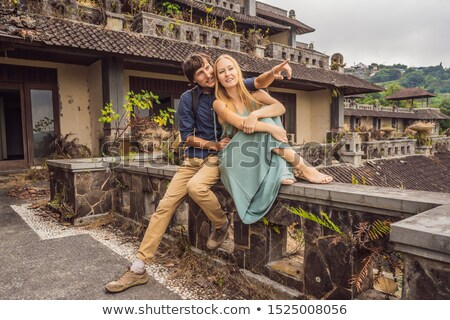 Happy couple in love in abandoned and mysterious hotel in Bedugul. Indonesia, Bali Island. Honeymoon Stock photo © galitskaya