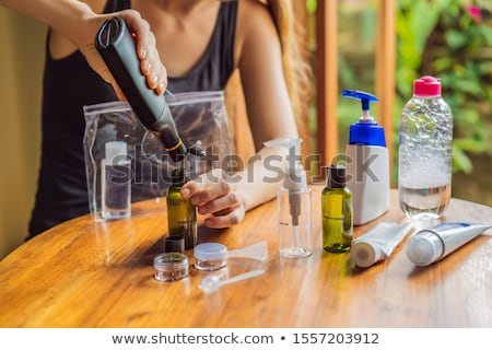 Travel kit for transporting cosmetics on an airplane. Cosmetics are ready to be poured into small bo Stock photo © galitskaya