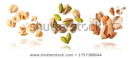Almond nuts levitate on a white background Stock photo © butenkow