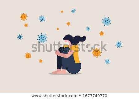 Coronavirus COVID-19 anxiety mental health problem sad woman wearing protective medical face mask si Stock photo © Maridav