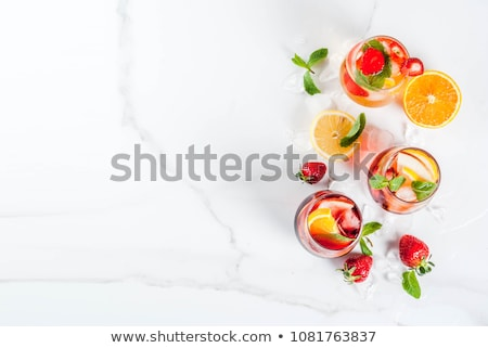 Delicious cold cocktail, fruit and mint ice. Stock photo © justinb