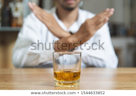 hand reject a glass of beer - concept stop alcoholism Stock photo © ozaiachin