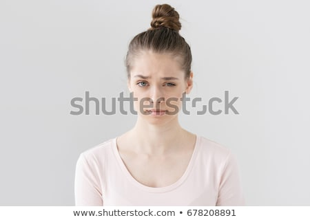 Girl with frown look Stock photo © zastavkin