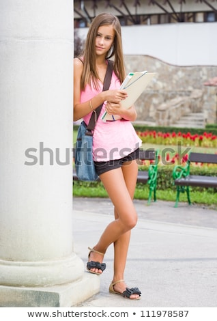Slender cute young brunette posing outdoors. Stock photo © lithian